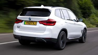 BMW iX3 SUV rear 3/4 tracking
