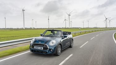 MINI Sidewalk Convertible driving on road in front of wind turbines