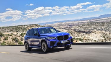 BMW X5 M Competition driving on road