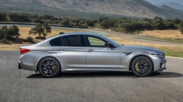BMW M5 Competition - side view static