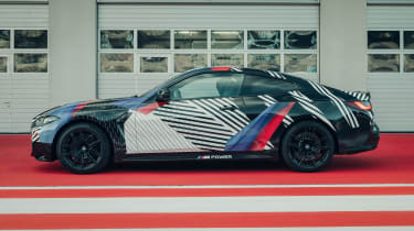New BMW M4 camouflaged side view