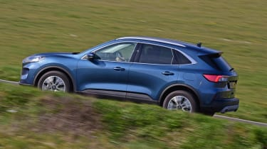 Ford Kuga driving up hill - side view