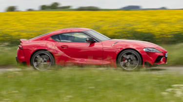 Toyota Supra coupe side panning country lane