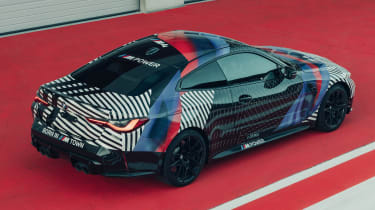 New BMW M4 camouflaged rear view