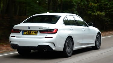 BMW 330e saloon rear 3/4 tracking
