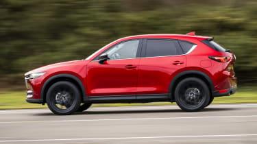 Mazda CX-5 Kuro driving - side