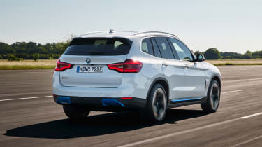 BMW iX3 driving - rear