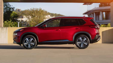 Nissan Rogue (X-Trail) parked - side view