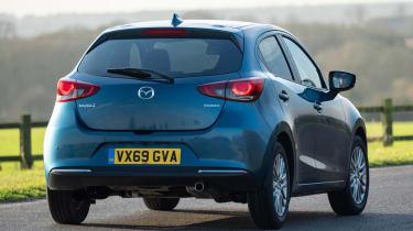 Mazda2 driving away from camera