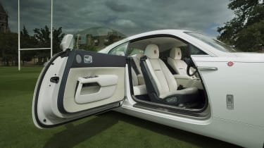 The dramatic rear-hinged doors are sure to turn heads and make every trip feel special