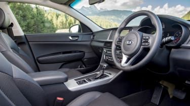 The interior is just like the regular Optima, save for a different set of gauges and some new buttons for its driving modes