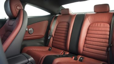 Room in the back seats is restricted by the sloping roofline and lack of rear doors