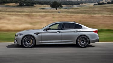 BMW M5 Competition - side view dynamic