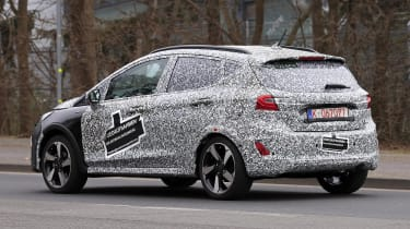 2021 Ford Fiesta in camouflage - side/rear view