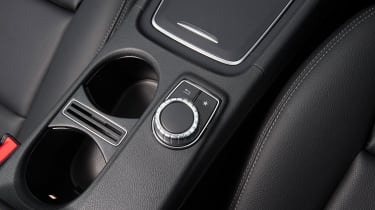 The Comand infotainment system is controlled by a wheel on the console