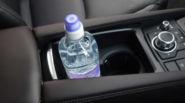 There are several handy storage cubbies inside the Mazda3