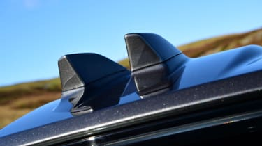 Distinctive dual shark fin antennas help mark the facelifted Evoque out from earlier examples