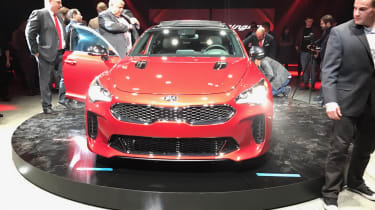 The Stinger's occupants sit low, with the driver facing a leather steering wheel, analogue dials & a colour LCD screen