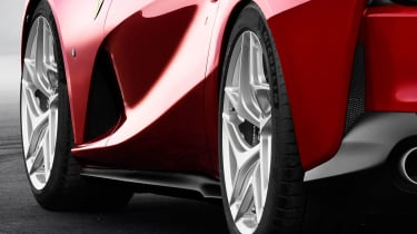 Sculpted sides are designed to funnel air to aid cooling and downforce at speed