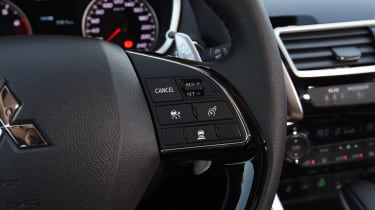 Steering wheel control buttons activate features such as active cruise control...