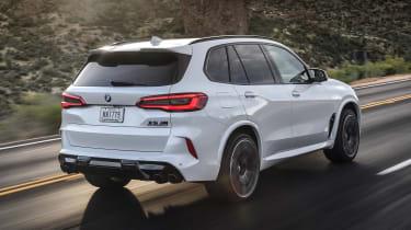 BMW X5 M SUV rear 3/4 tracking