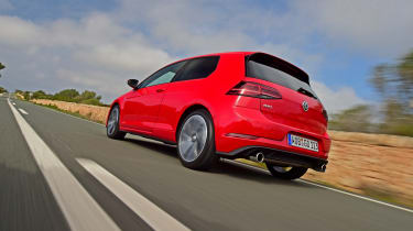 Twin tailpipes and tinted rear light clusters help set the Golf GTI apart from other versions in the range