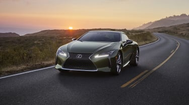Lexus LC Limited Edition driving in front of sunset