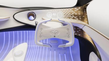 Despite this futuristic tech, a physical accelerator and brake pedal still feature