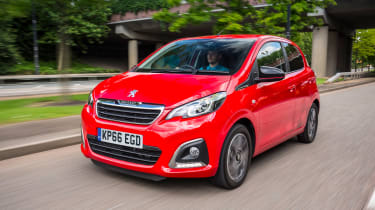 Red Peugeot 108 driving