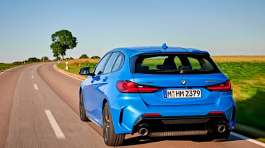 BMW M135i driving - rear view