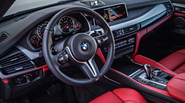 The X5 M gets Merino leather upholstery as standard, along with black headlining