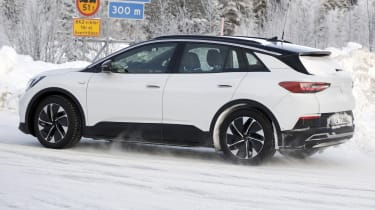 2021 Volkswagen ID.4 SUV - winter testing side on view passing
