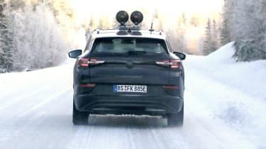 Volkswagen ID.4 prototype driving away from camera