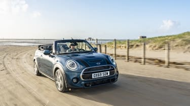 MINI Sidewalk Convertible driving on beach with roof down