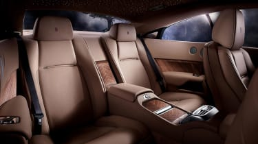 The individual rear seats are separated by a console and offer impressive comfort and legroom