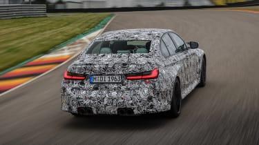 2020 BMW M3 saloon prototype - rear 3/4 view cornering