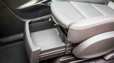 The interior is dotted with lots of useful storage areas