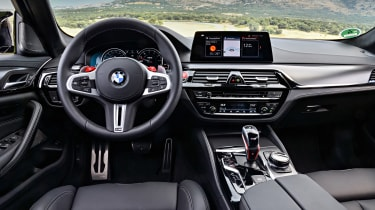 BMW M5 Competition - steering wheel and dashboard