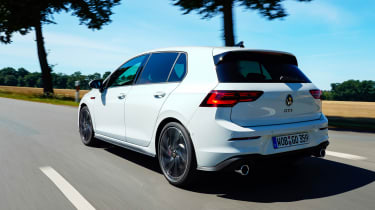 Volkswagen Golf GTI hatchback side tracking