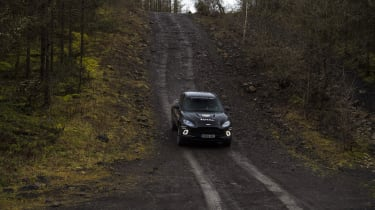 Aston Martin DBX prototype driving on off-road track