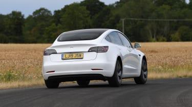 Tesla Model 3 cornering - rear view