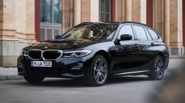 2020 BMW 330e Touring - front 3/4 view