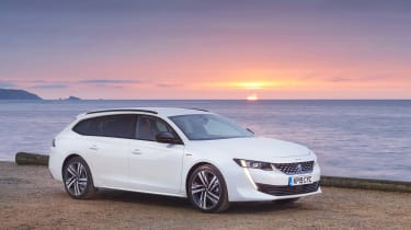 White Peugeot 508 SW with sunset backdrop
