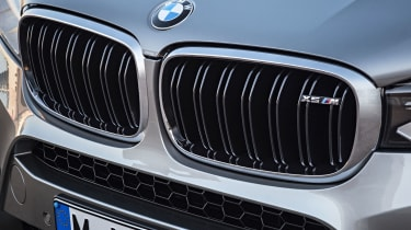 The iconic BMW kidney grille gets an M badge just in case bystanders don't hear the quad exhaust